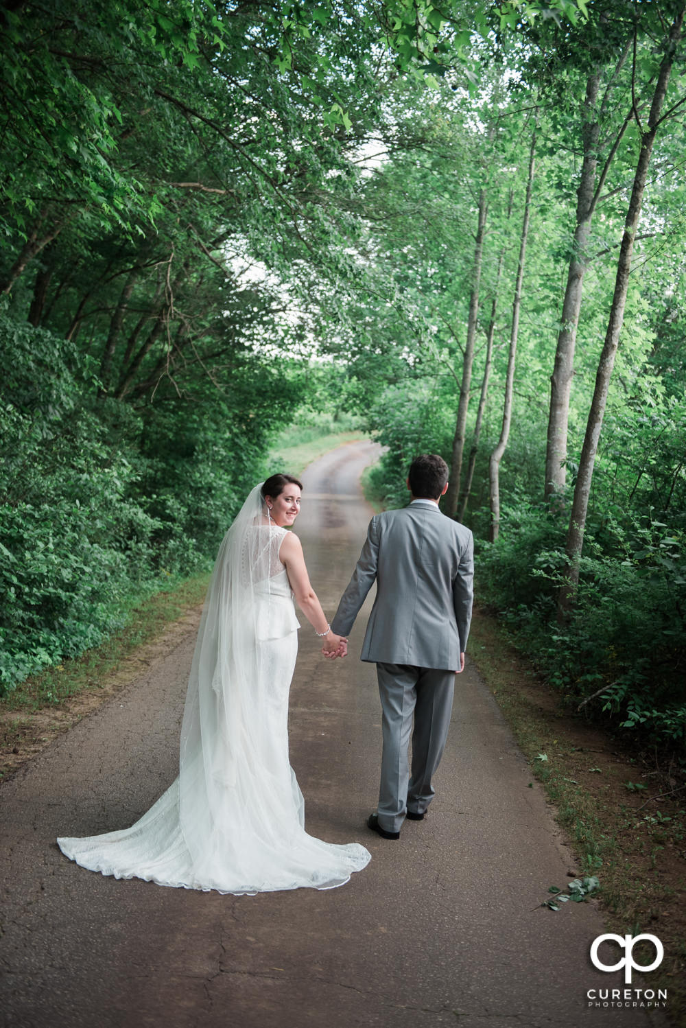 Bride and groom walking down the road.