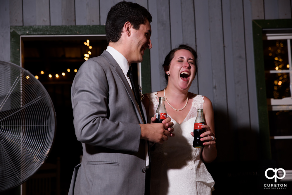 Bride and groom watching a toast.