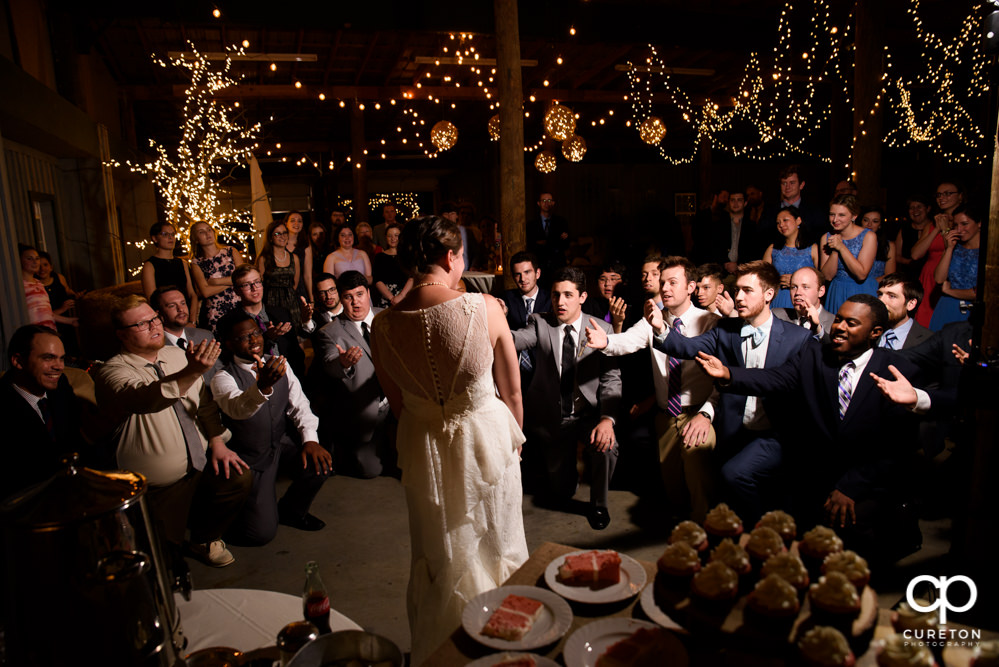 Groom's fraternity singing to his bride at their wedding reception.