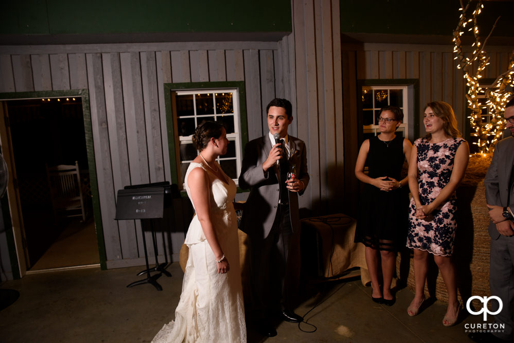 Groom gives a speech at the reception.