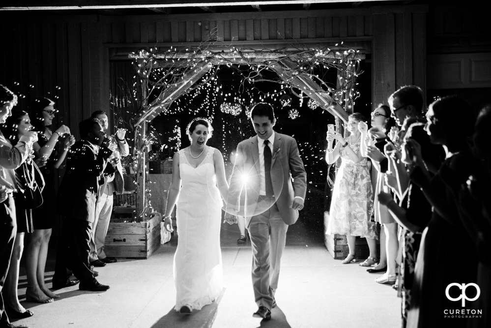 Bride and groom leaving the reception.