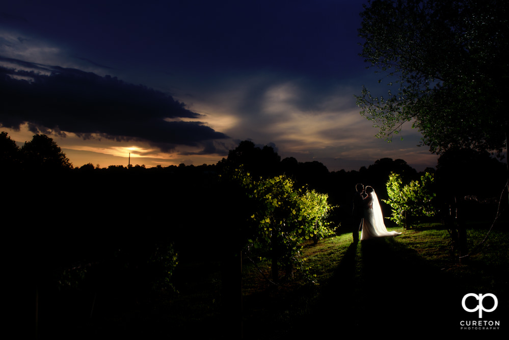 Bride and groom at sunset at Greenbrier Farms in Easley SC after their epic wedding day.