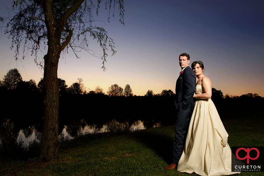 Bride and Groom at sunset at their Greenbrier Farms wedding reception.