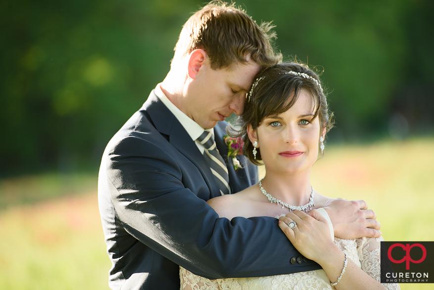 Couple hugging their Greenbrier Farms wedding.