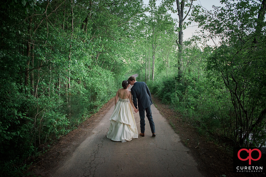 Couple kissing after their rustic farm wedding near Greenville,SC.