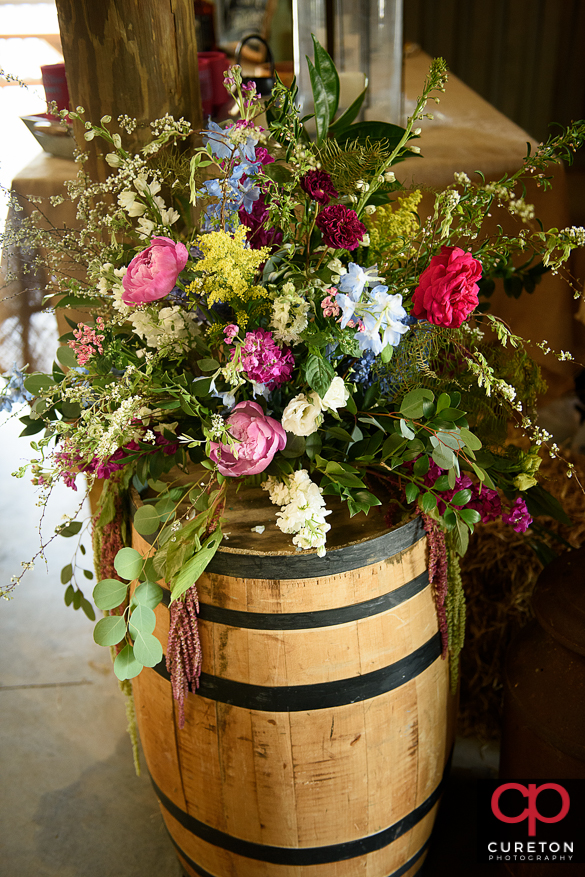 Flowers by willow floral on a whickey barrel.