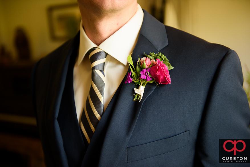 Closeup of the groom's flower.