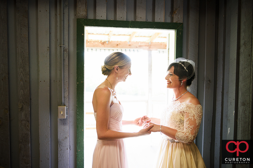 Bride and maid of honor standing in the doorway.