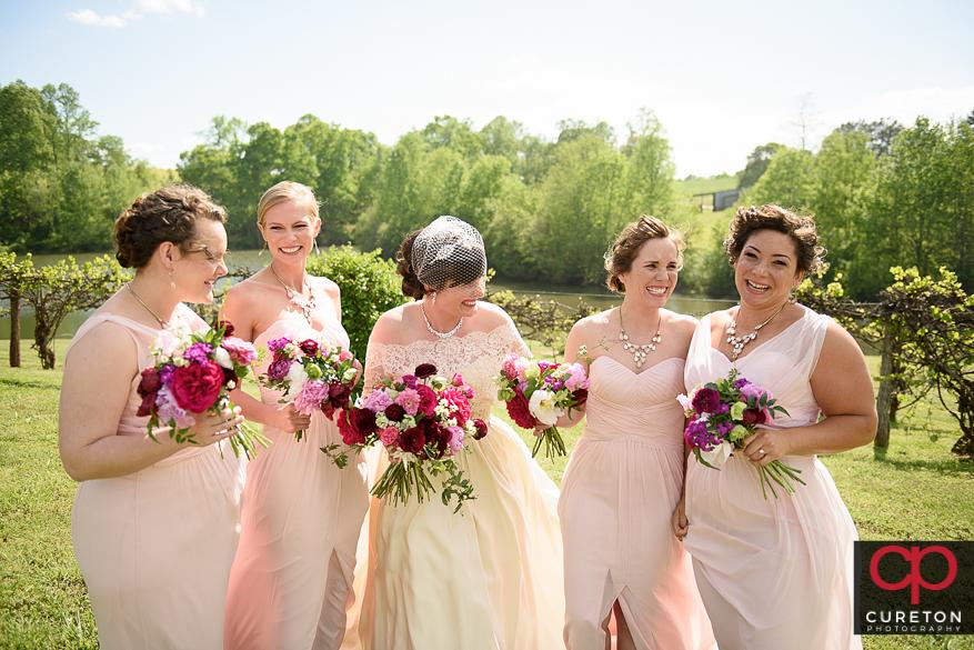 Bride and bridesmaids having fun before the wedding.