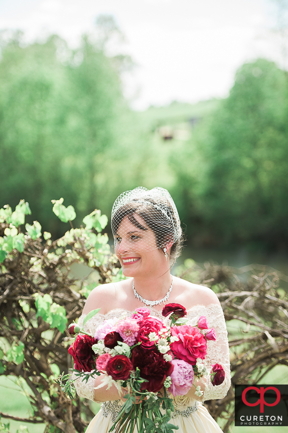 Bride holding her flowers at Greenbrier farms.