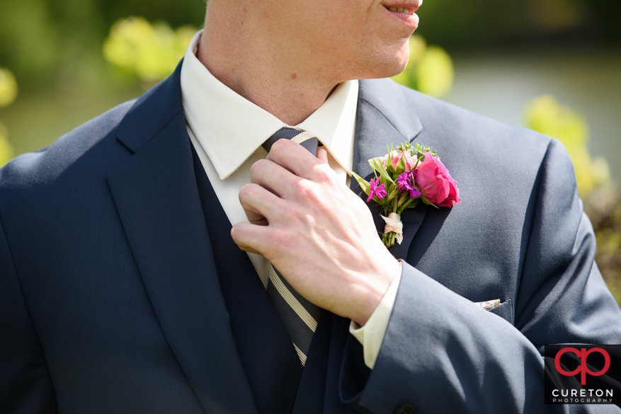 Closeup of groom and his tie.