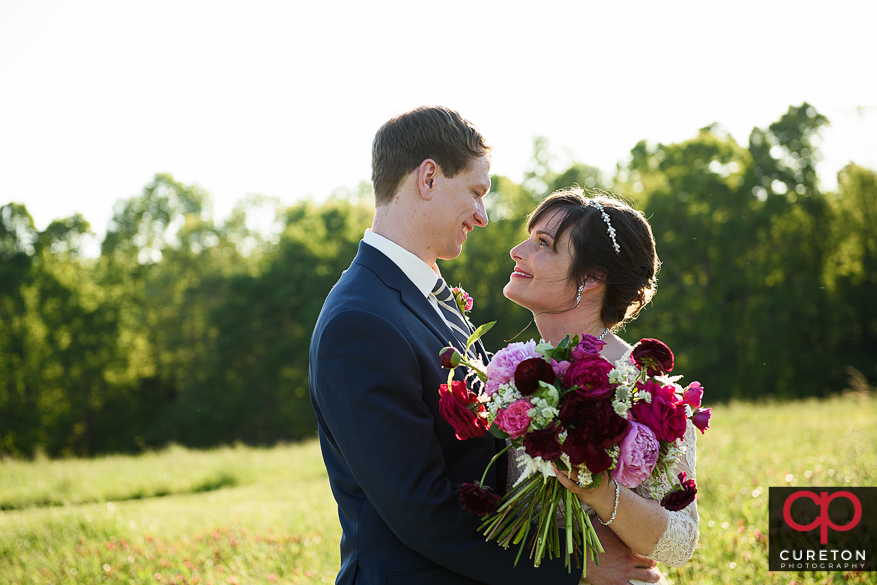 Bride and groom in a field on the farm