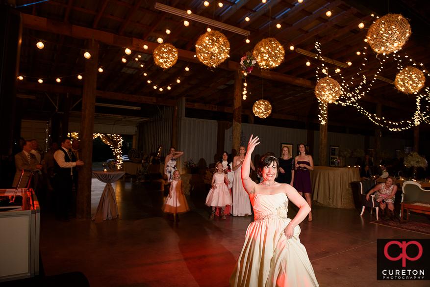 Bride throwing her bouquet.