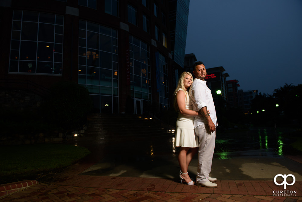 Groom and bride with the downtown city lights.