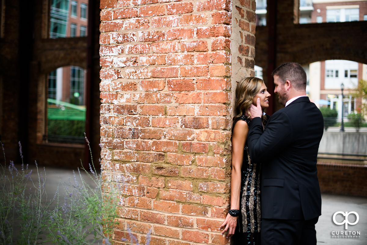 Engaged couple looking at each other at the Wyche Pavilion in Greenville,SC.