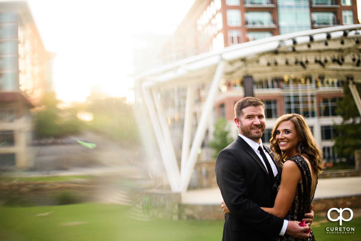 Bride and groom dancing outside the Wyche Pavilion during their downtown Greenville engagement session.