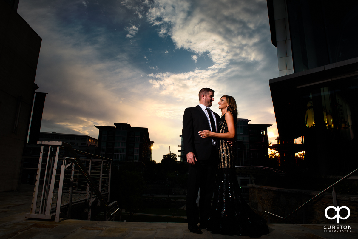 Future bride and groom at sunset in downtown Greenville.