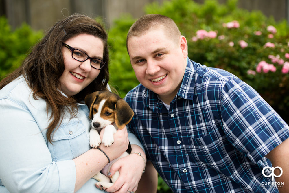 Bride and groom with beagle puppy.