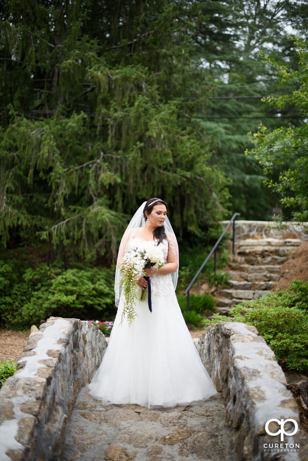 Bride on the stone bridge during her bridal portrait session in downtown Greenville.