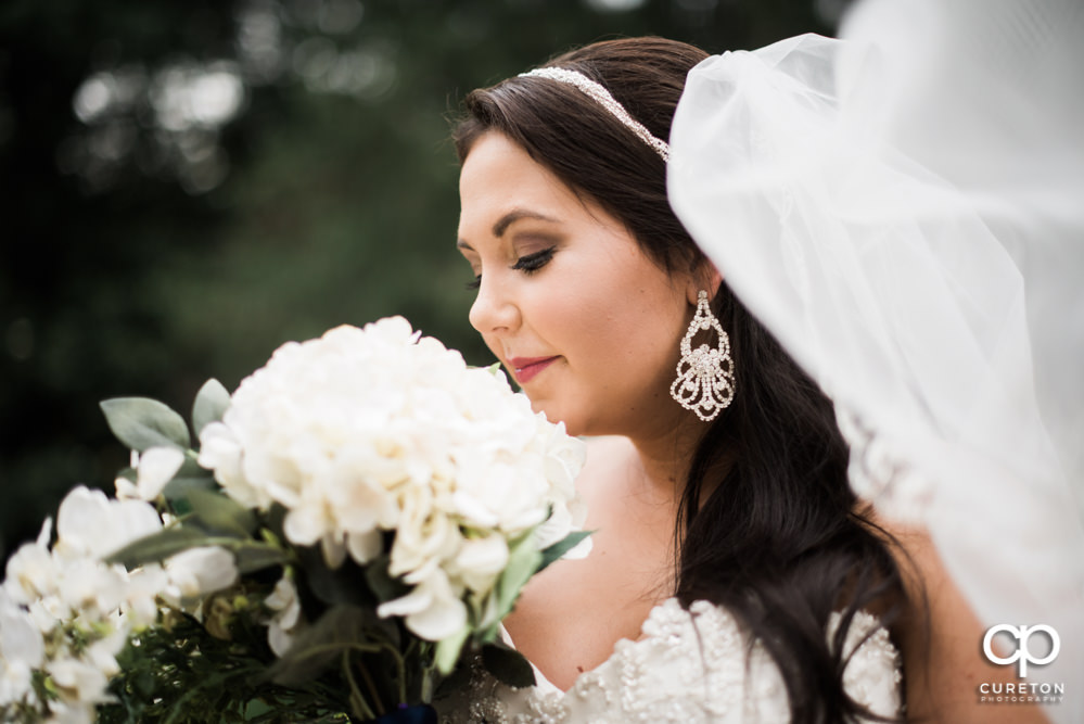 Bride smelling her flowers during her bridal session.