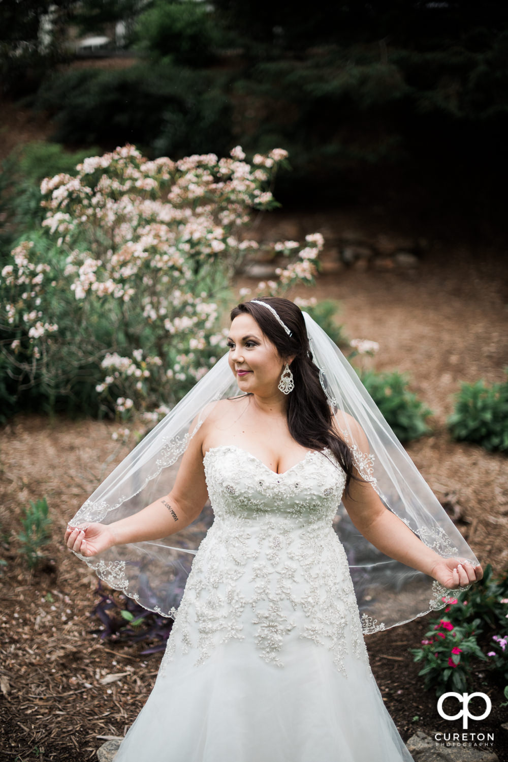 Bride holding her veil out in the wind at her bridal session.
