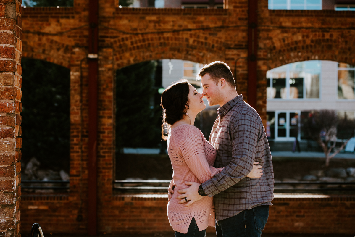 Couple snuggling during their January Engagement Session in downtown Greenville,SC.
