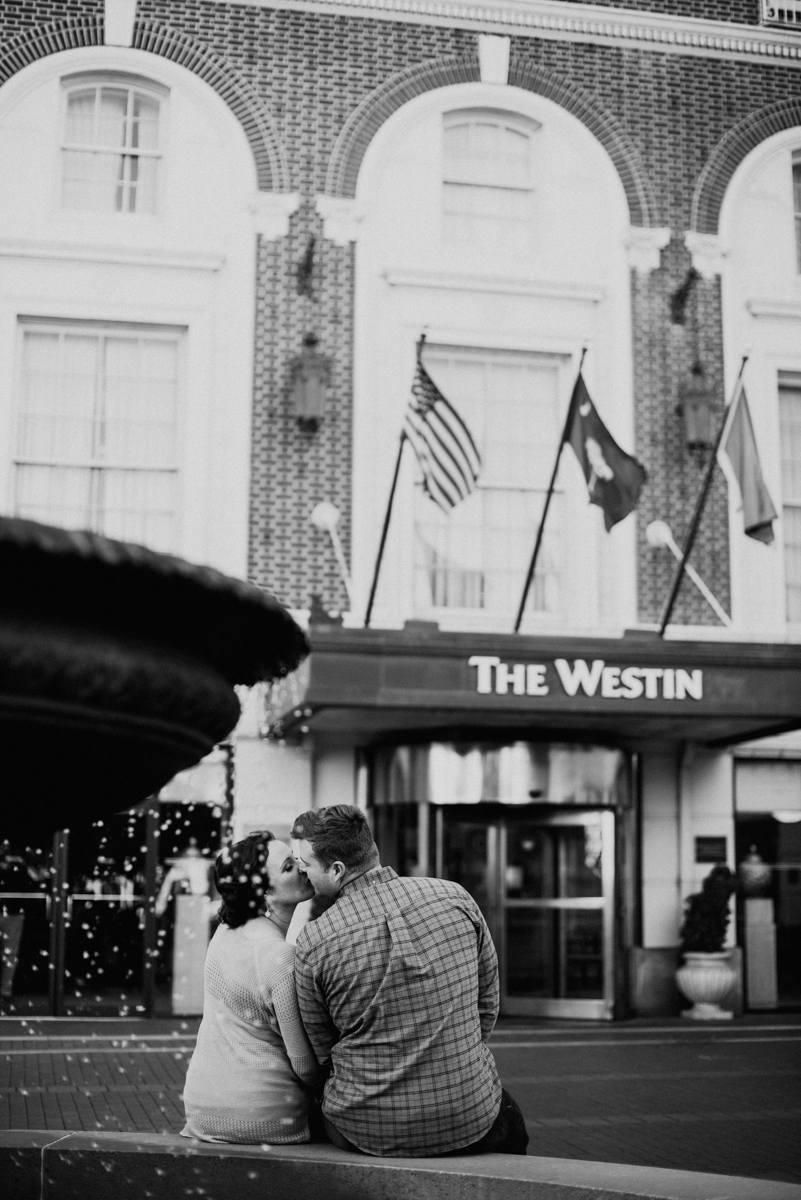 Bride and groom kissing in front of the Westin in downtown Greenville.