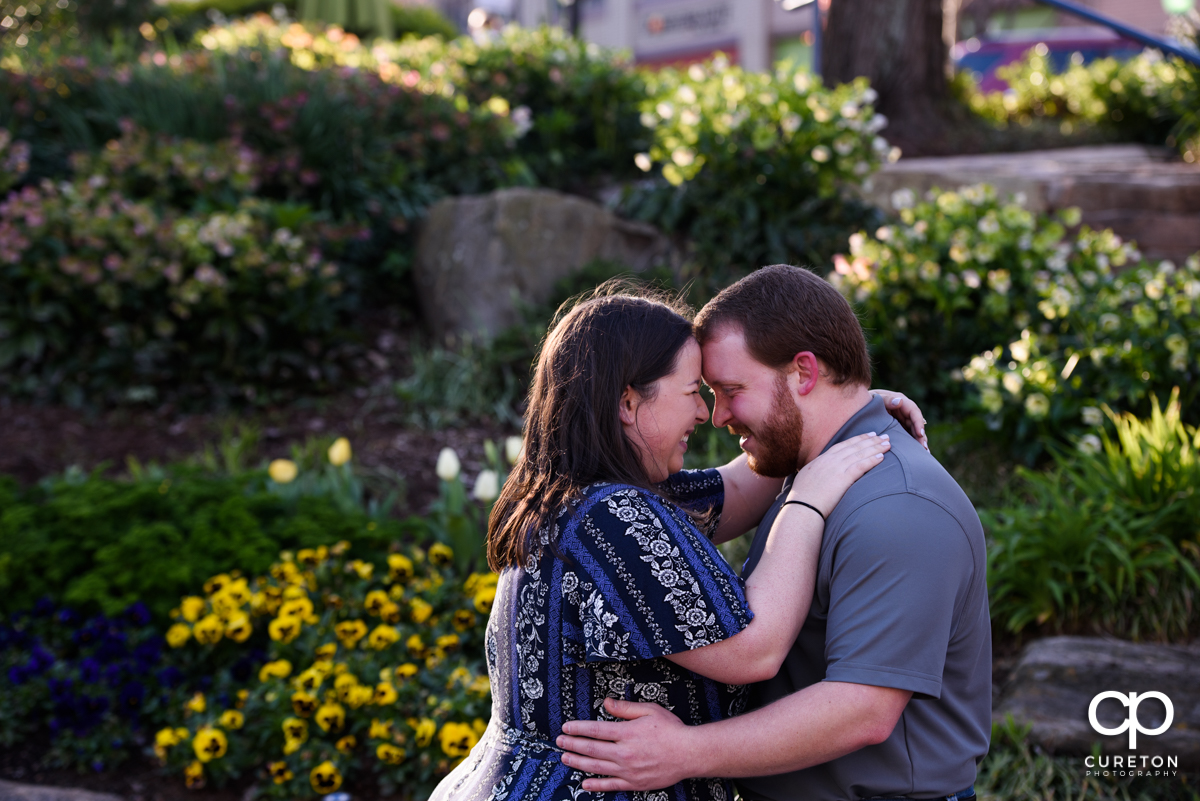 Engaged couple eskimo kissing during a Greenville,SC park engagement session.