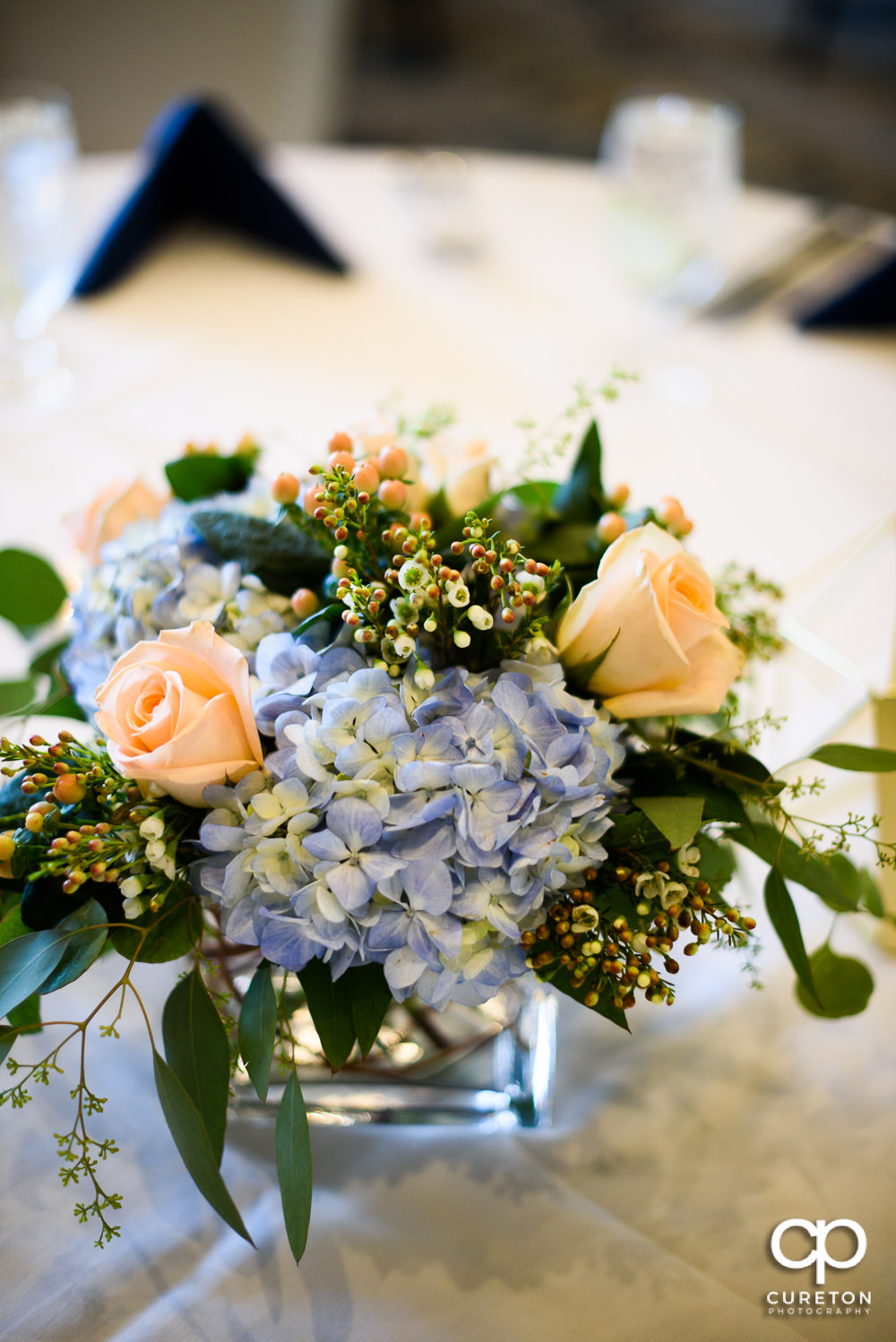 Floral centerpieces at the wedding rehearsal dinner at the Thornblade Country Club in Greenville , SC .