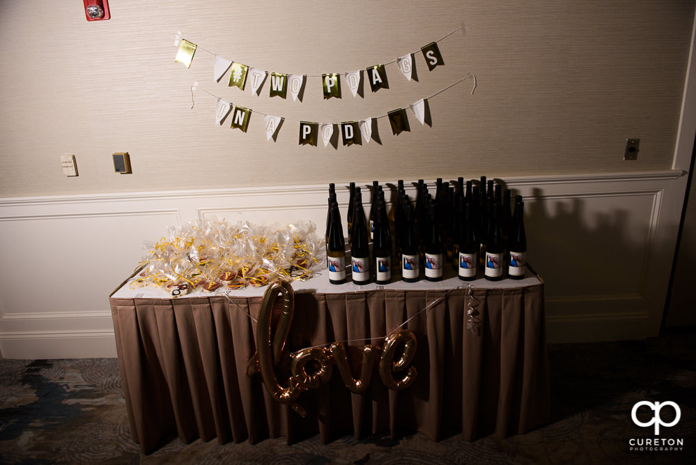 Wine bottles and favors at the wedding rehearsal dinner.