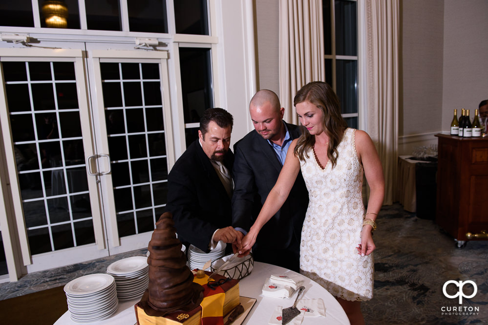 Bride and groom cutting the rehearsal cake.