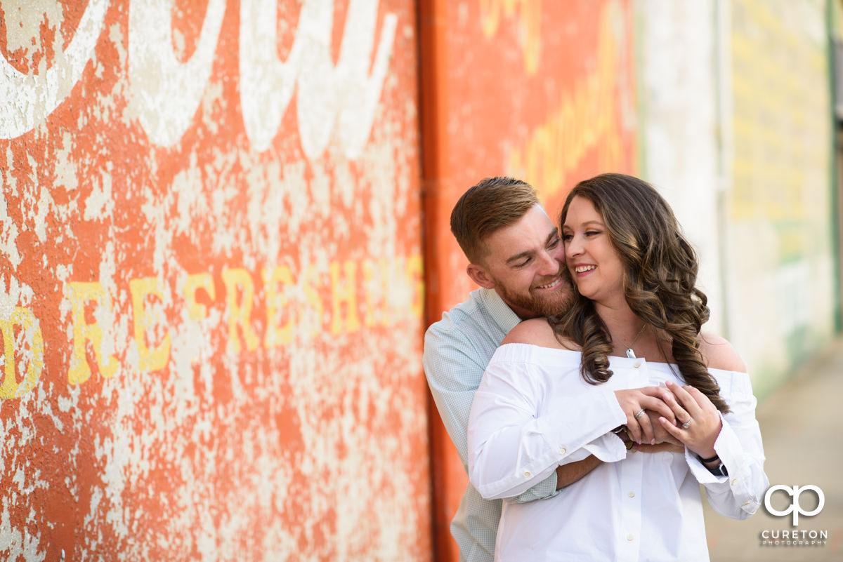 Man hugging his wife during a Greenville,SC anniversary session.