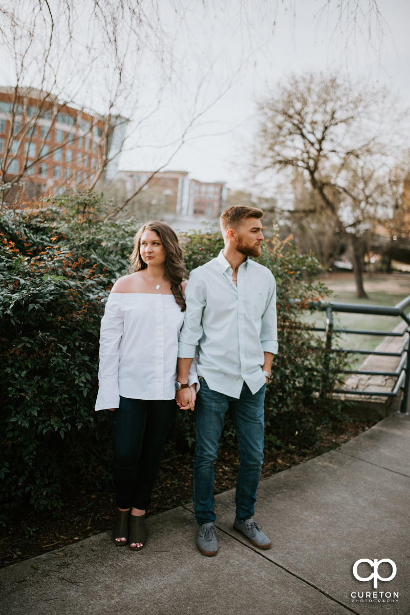 Husband and wife strolling though the park during a Greenville,SC anniversary session.
