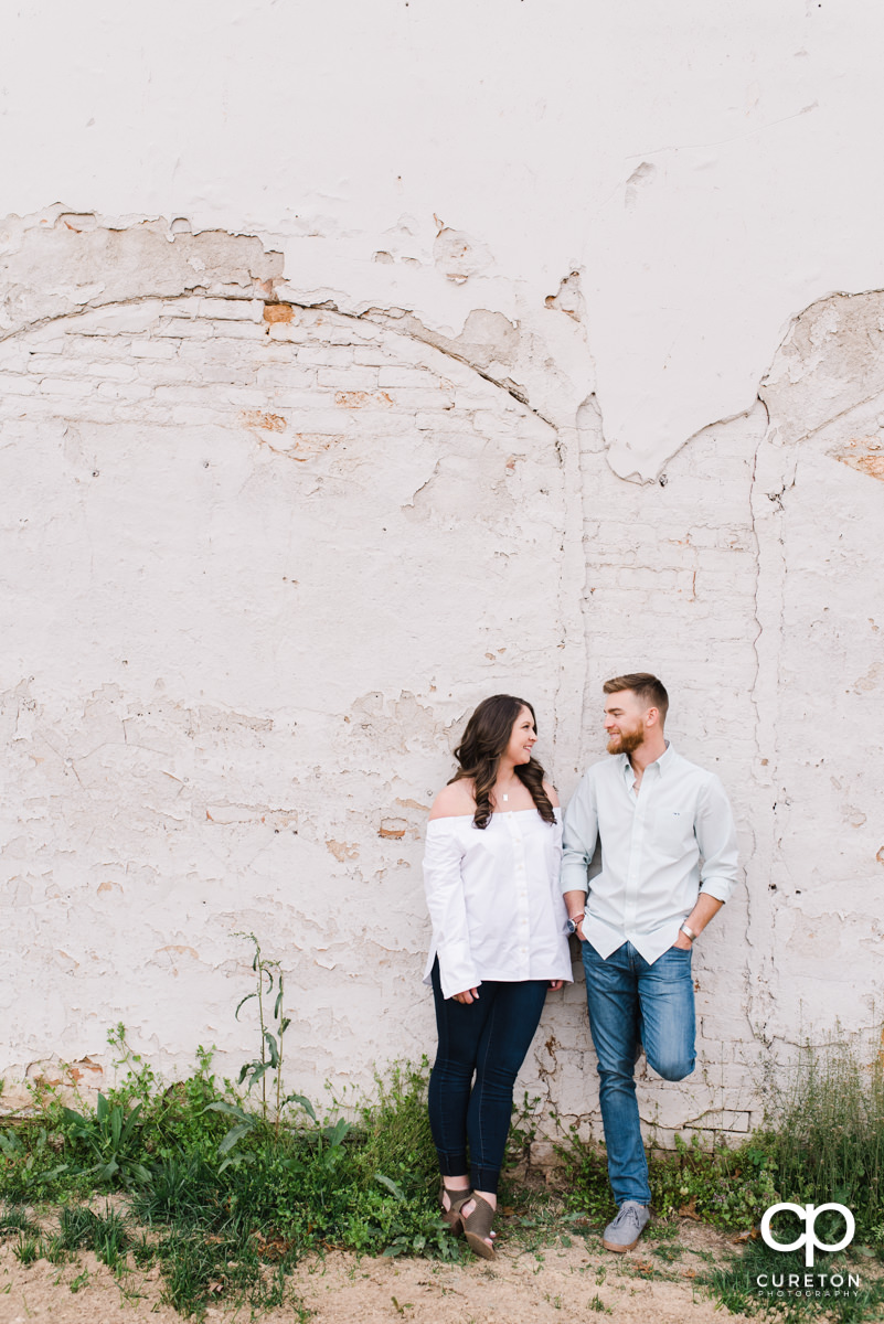 Man and his wife smiling at each other during a Greenville,SC anniversary session.