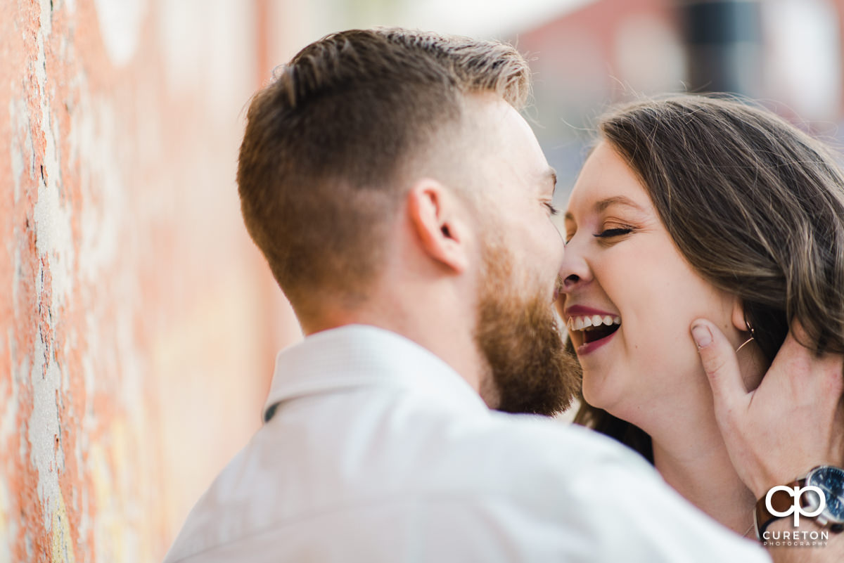 Woman laughing at her husband during a Greenville,SC anniversary session.