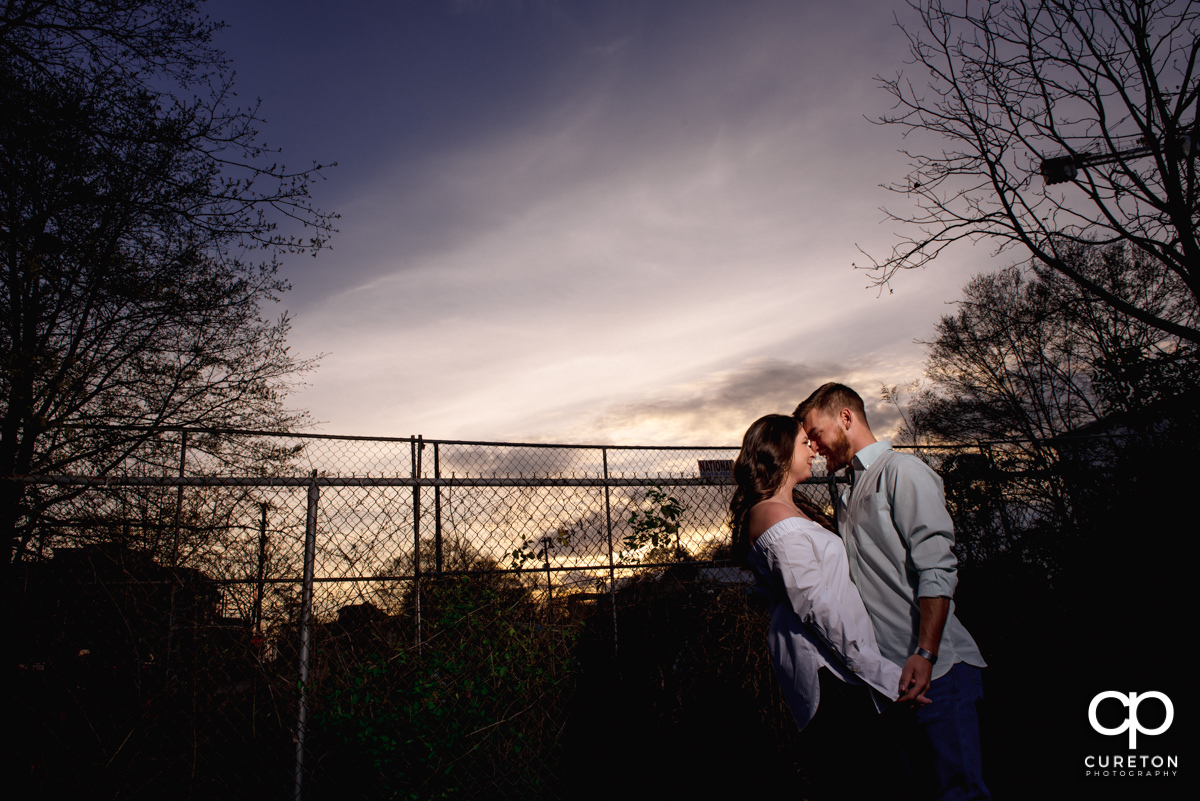 Couple dancing at sunset during a Greenville,SC anniversary session.