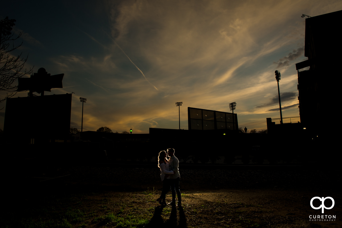 Married couple dancing in front of Fluor Field during a Greenville,SC anniversary session.