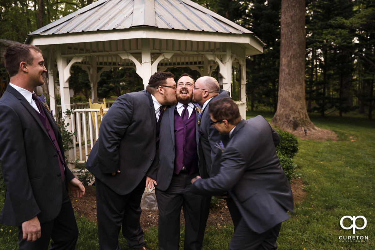 Groomsmen attacking the groom before the wedding at The Grove at Pennington.