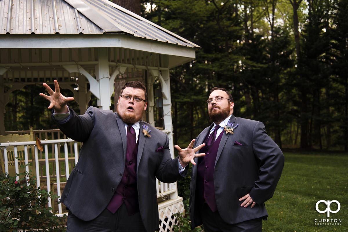 Groom and his groomsman posing.