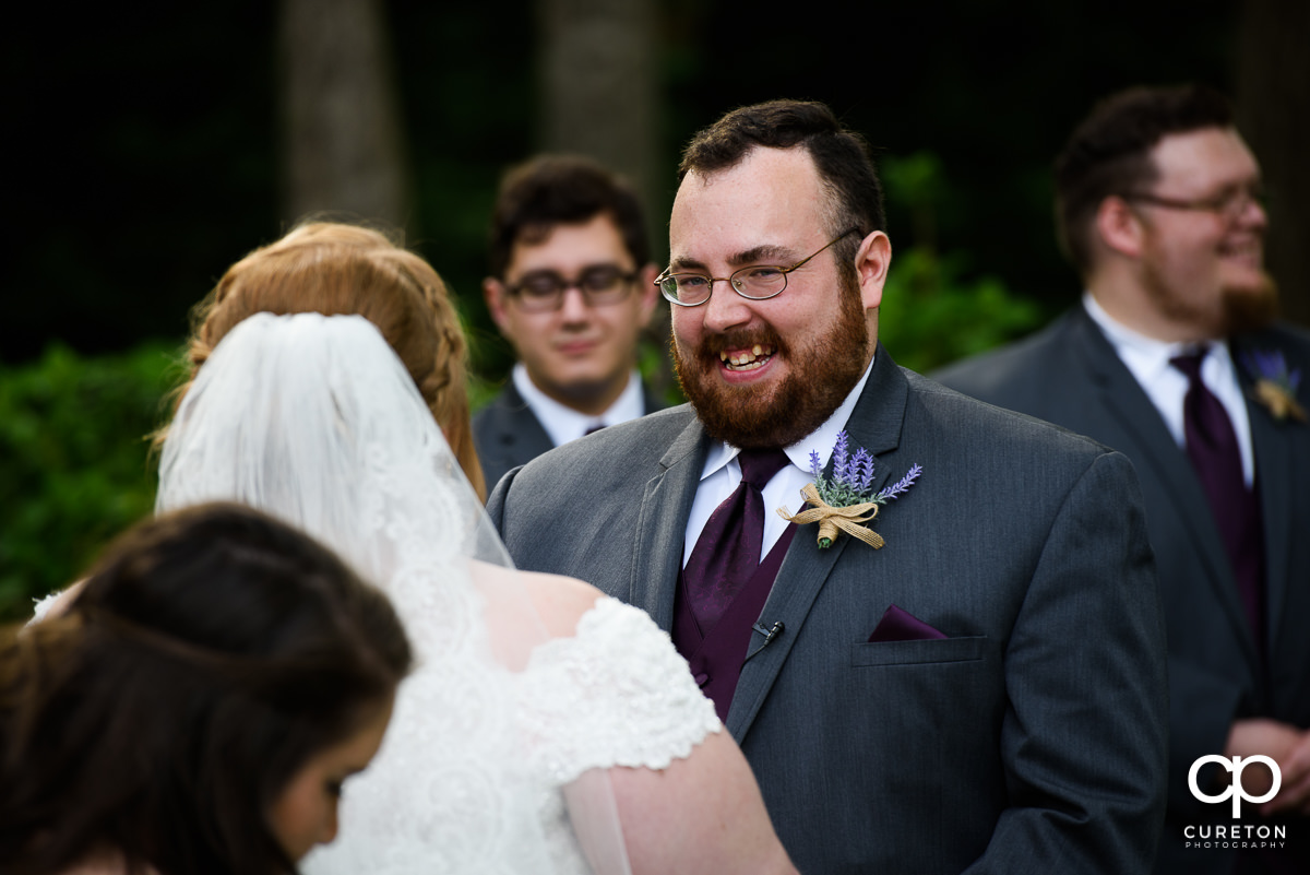 Groom smiling at at the Grove at Pennington wedding.