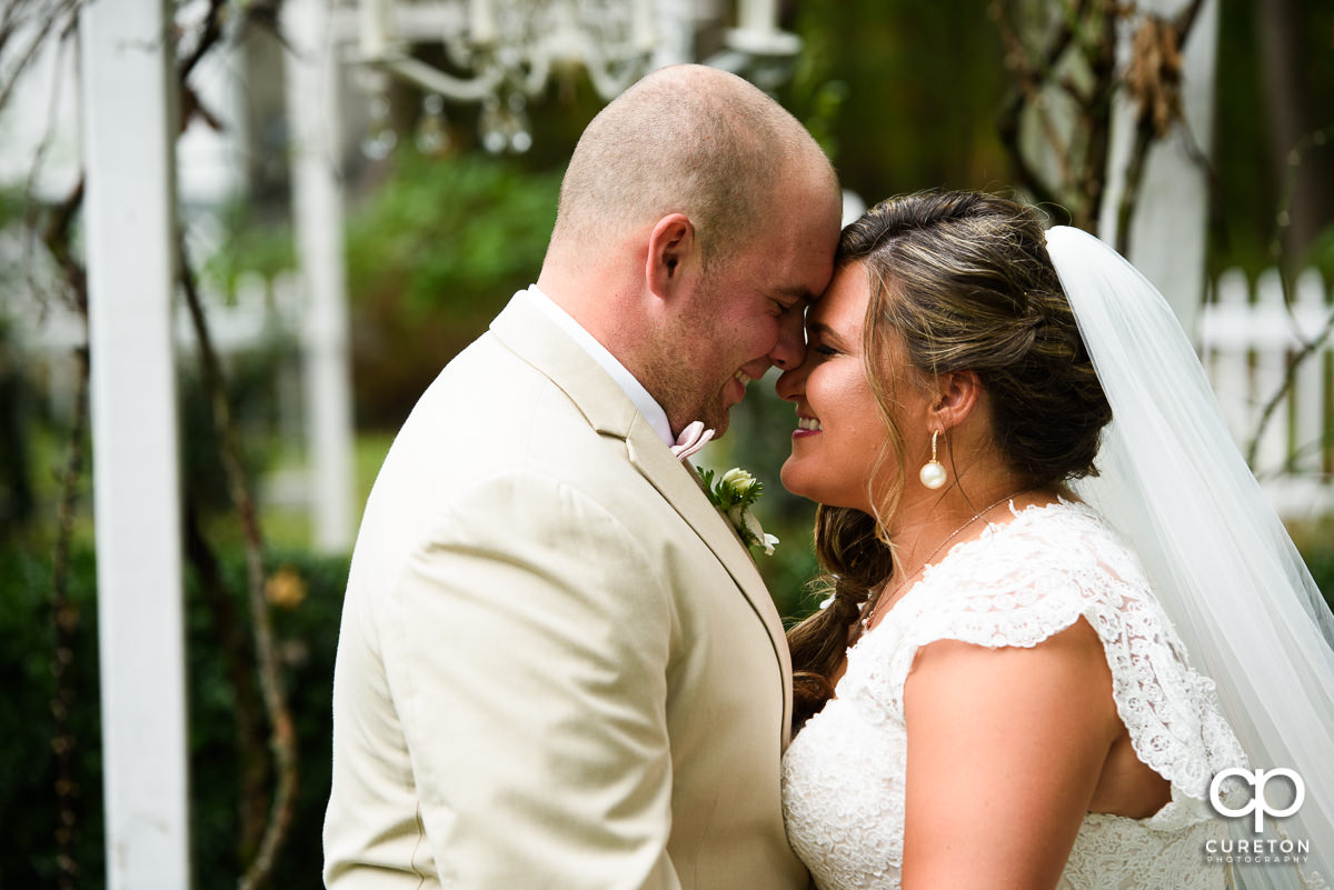 Bride and Groom smiling during their first look before the ceremony.