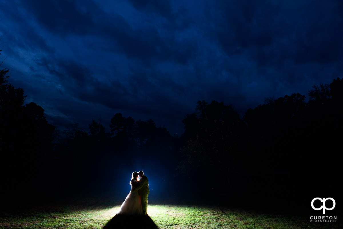 Bride and groom in the field after their rustic wedding at The Grove at Pennington.