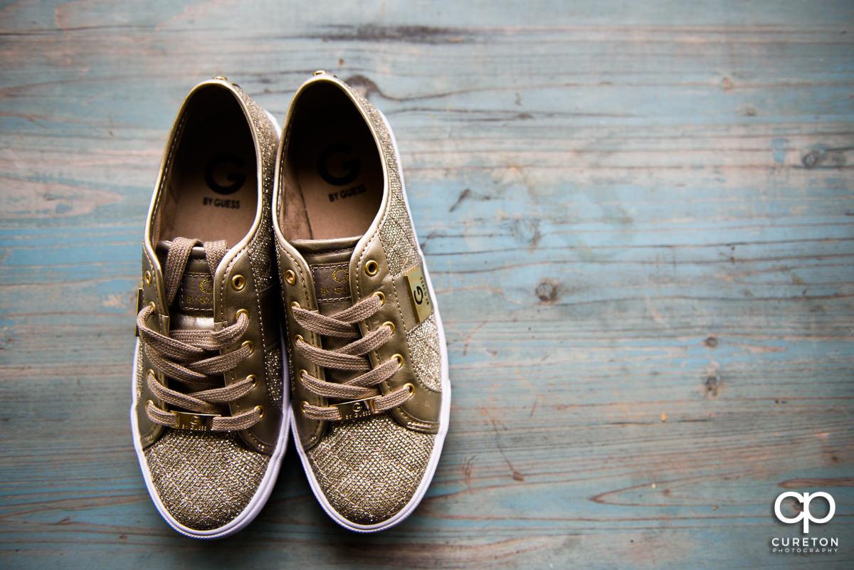 Bride's gold shoes.