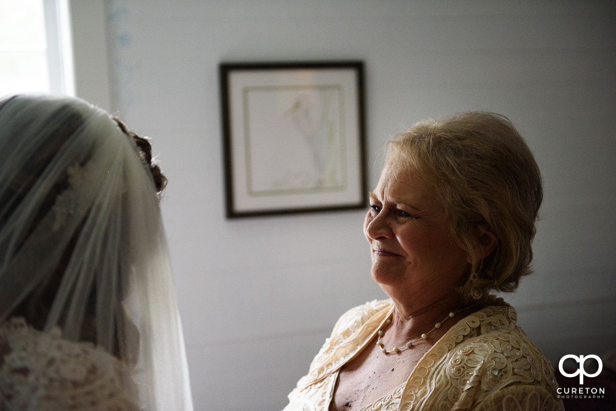Bride's mom smiling.