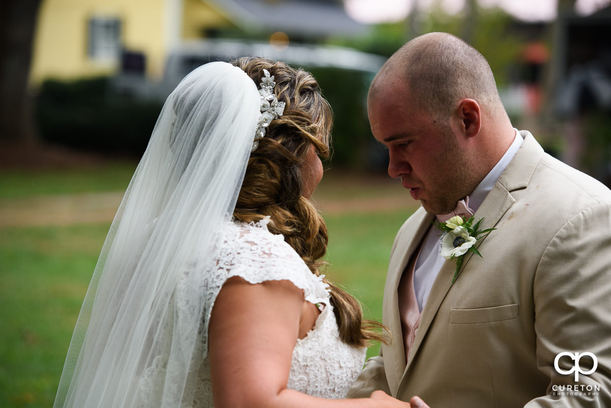 Groom getting emotional when he sees his bride at their first look.
