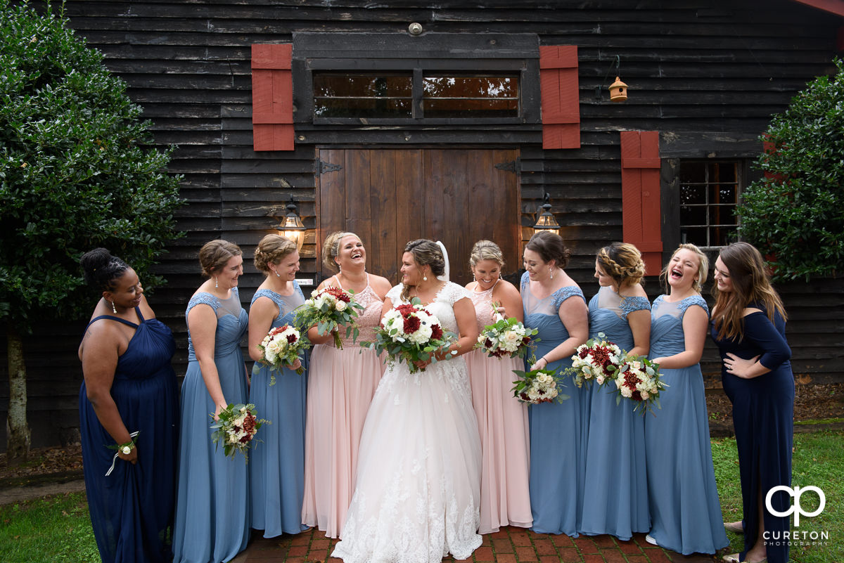 Bridesmaids talking an laughing together before the wedding at The Grove at Pennington.