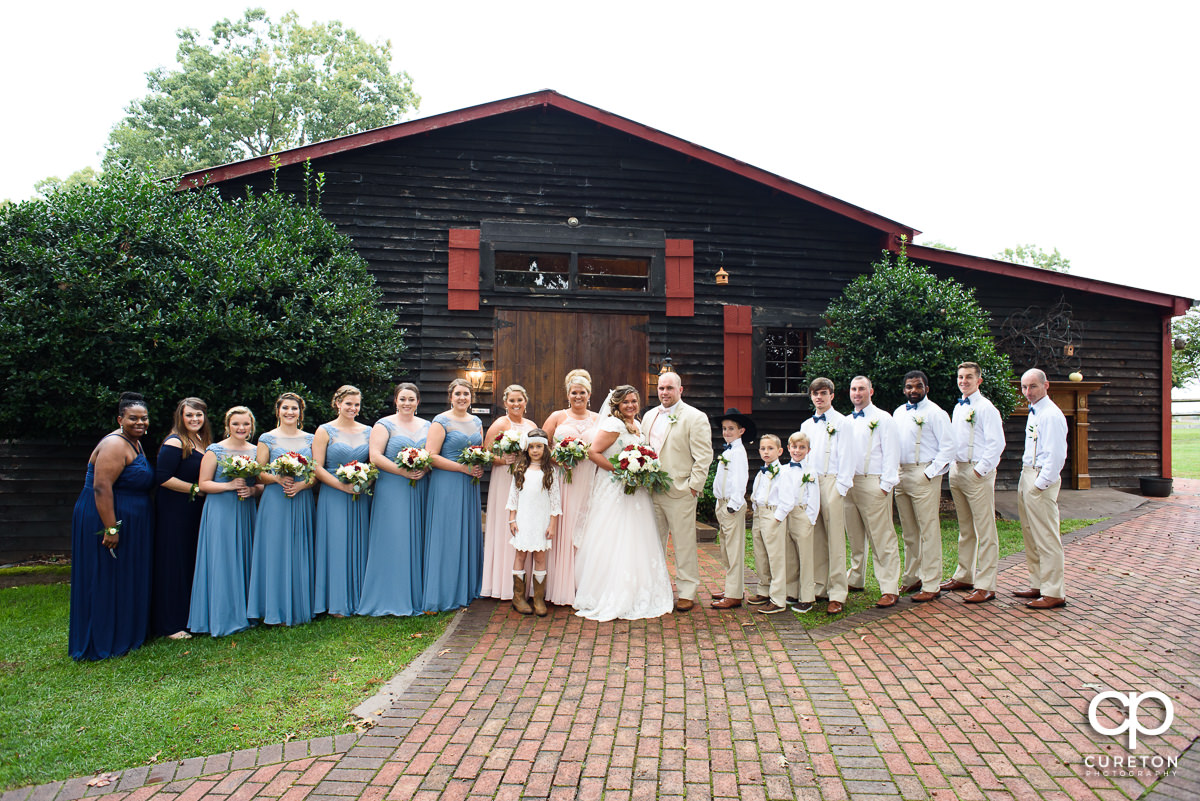 Wedding party in front of the barn at The Grove at Pennington.