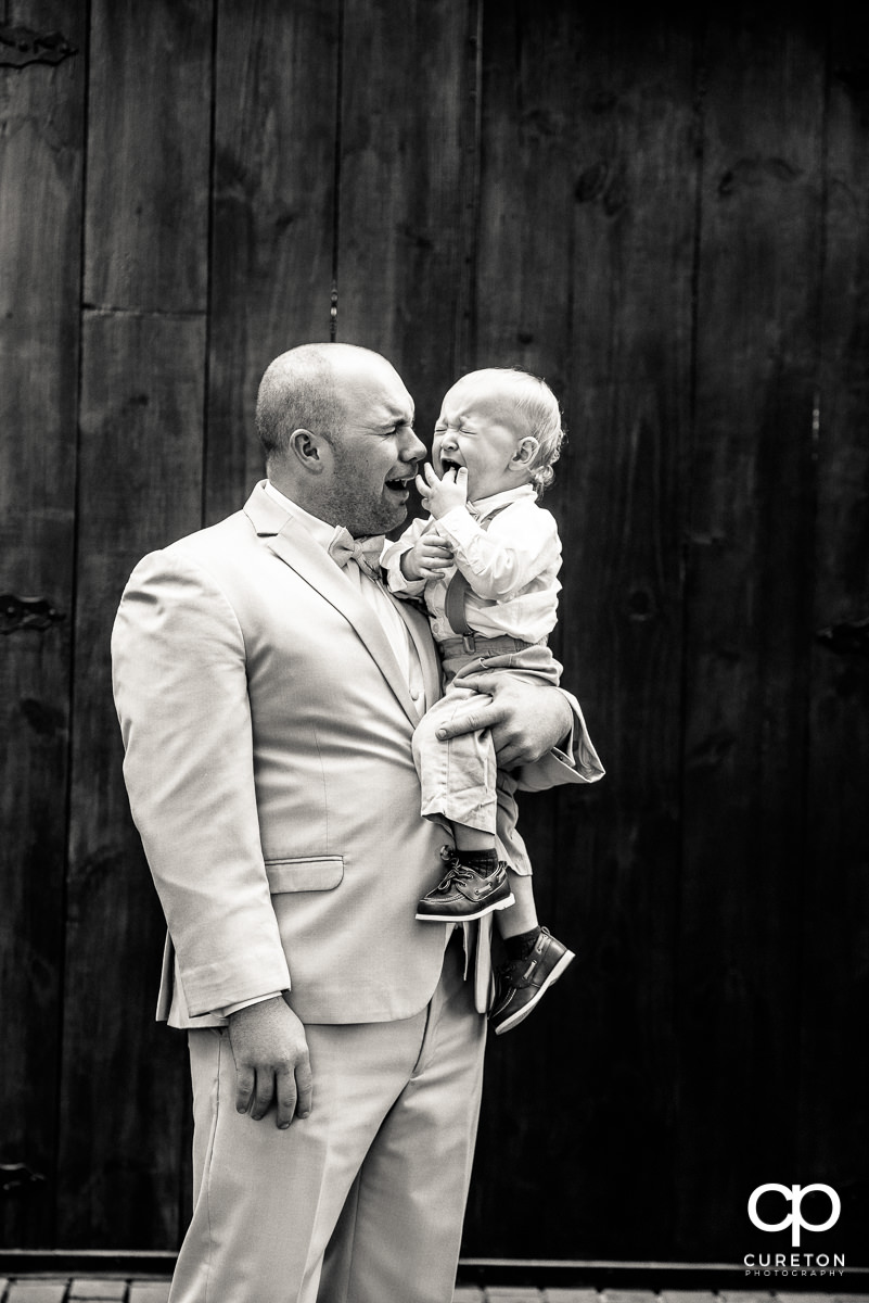 Groom and the ring bearer both crying.