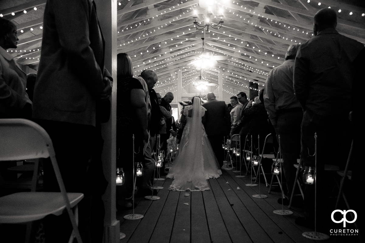 Bride and father walking down the aisle.