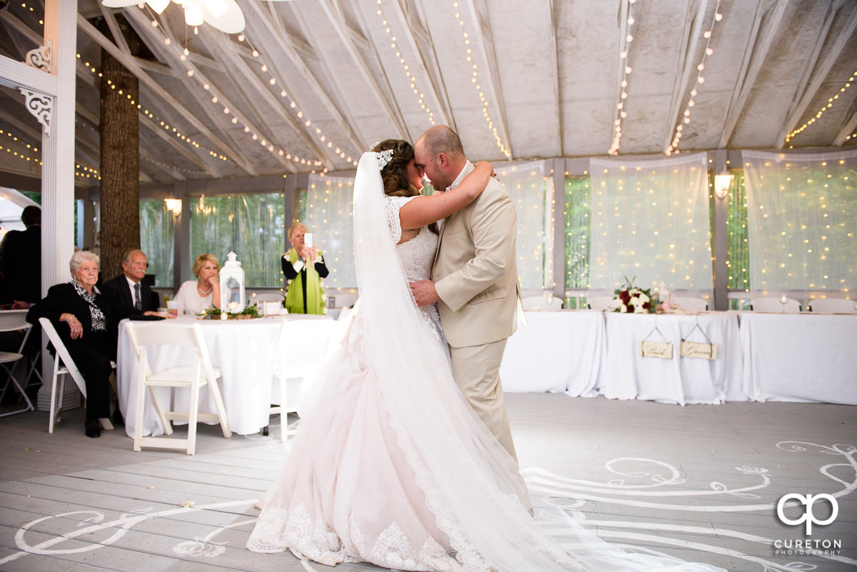 Bride and groom sharing their first dance at the wedding reception at The Grove at Pennington.